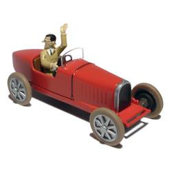 54. La voiture de course de...